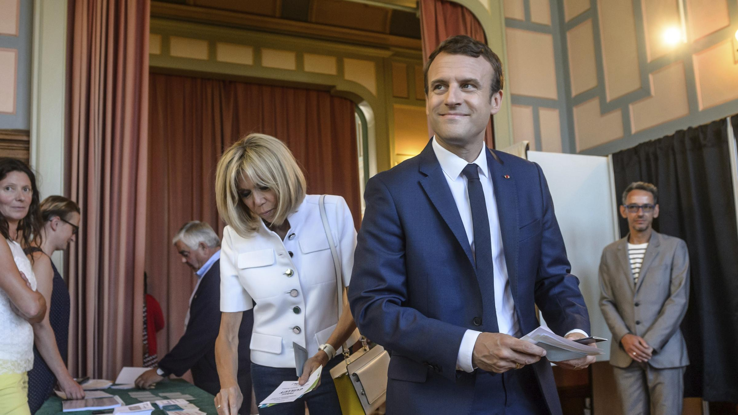 Early projections suggest Macron's REM party winning majority